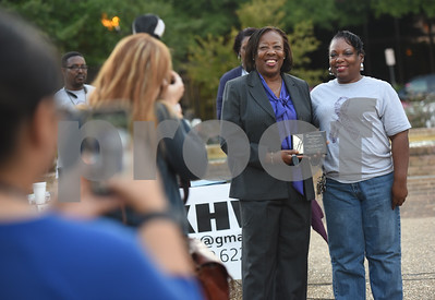 Verona Jones of Tyler ISD, left, receives an award from Angela Gray during the East Texas Crisis Center Domestic Violence Awareness Month Hope Awards held Wednesday night at T.B. Butler Fountain Square.  (Sarah A. Miller/Tyler Morning Telegraph)