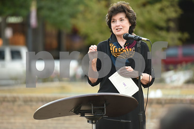 Executive director Lana Peacock speaks at the East Texas Crisis Center Domestic Violence Awareness Month Hope Awards held Wednesday night at T.B. Butler Fountain Square.  (Sarah A. Miller/Tyler Morning Telegraph)