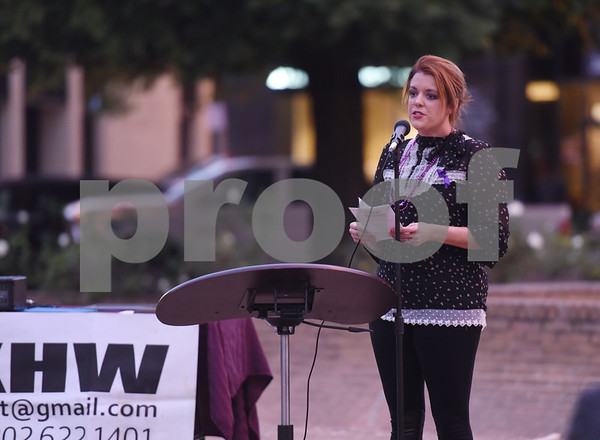 Domestic violence survivor Amanda Ground reads a poem during the East Texas Crisis Center Domestic Violence Awareness Month Hope Awards held Wednesday night at T.B. Butler Fountain Square.  (Sarah A. Miller/Tyler Morning Telegraph)