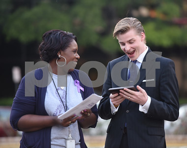 Yulonda Boyd gives Emil Mikkelson of the District Attorney's Office an award at the East Texas Crisis Center Domestic Violence Awareness Month Hope Awards held Wednesday night at T.B. Butler Fountain Square.  (Sarah A. Miller/Tyler Morning Telegraph)