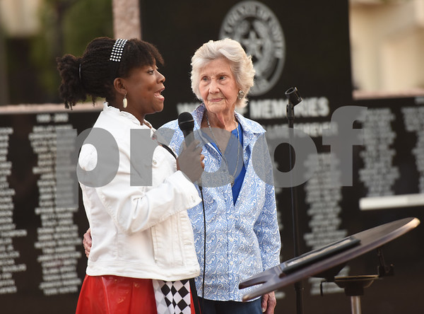 Alva Borens, left, presents teacher Frankie Smith with an award at the East Texas Crisis Center Domestic Violence Awareness Month Hope Awards held Wednesday night at T.B. Butler Fountain Square.  (Sarah A. Miller/Tyler Morning Telegraph)