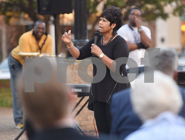 Pastor Delois Buchanan of YAHWEH Christian Church in Longview gives the keynote address at the East Texas Crisis Center Domestic Violence Awareness Month Hope Awards held Wednesday night at T.B. Butler Fountain Square.  (Sarah A. Miller/Tyler Morning Telegraph)