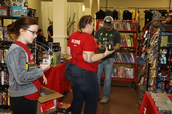 Vendor from Half Price Books set up booth at the East Texas Rose Comic Con.