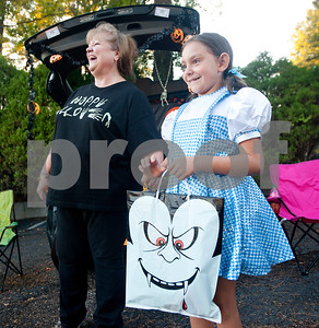 "Sophia Fleming, 8, of Tyler dresses as Dorothy from ""The Wizard of Oz"" as she collects candy at Trunk or Treat at the Crown Health Services parking lot in Tyler, Texas Thursday Oct. 29, 2015.  Crown Health Services staff members decked out their cars with Halloween-inspired decorations and free candy for children.    (Sarah A. Miller/Tyler Morning Telegraph)"