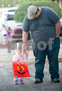 Laura Kienitz, 1, holds hands with her father Bobby Kienitz as they attend the Trunk or Treat at the Crown Health Services parking lot in Tyler, Texas Thursday Oct. 29, 2015.  Crown Health Services staff members decked out their cars with Halloween-inspired decorations and free candy for children.    (Sarah A. Miller/Tyler Morning Telegraph)
