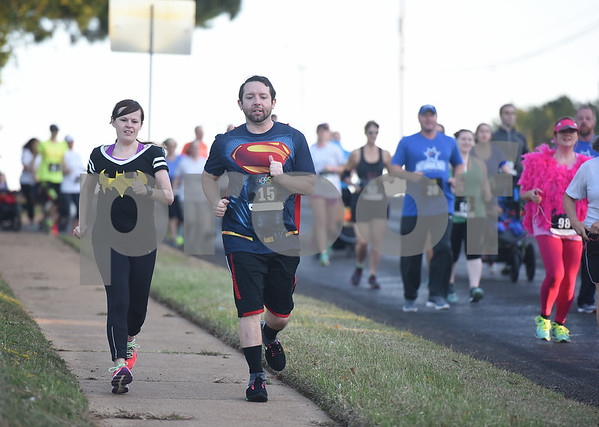 Danielle and Noah Sepulveda of Tyler run in the Run for Your Life 5k sponsored by the Smith County Medical Society Foundation during the Fit City Day in the Park event at Fun Forest Park in Tyler Saturday Oct. 29, 2016. Fit City Coalition sponsored fitness activities such as yoga and zumba classes, health screenings, a plank contest and health related vendors at the annual event.  (Sarah A. Miller/Tyler Morning Telegraph)