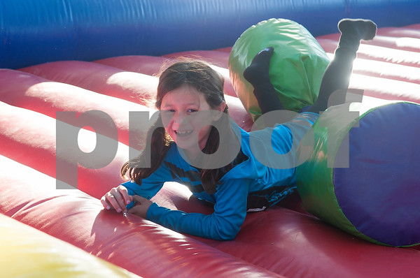 Sophia Mitchell, 7, of Tyler, falls over as she jousts during the Fit City Day in the Park event at Fun Forest Park in Tyler Saturday Oct. 29, 2016. Fit City Coalition sponsored fitness activities such as yoga and zumba classes, health screenings, a plank contest and health related vendors at the annual event.  (Sarah A. Miller/Tyler Morning Telegraph)