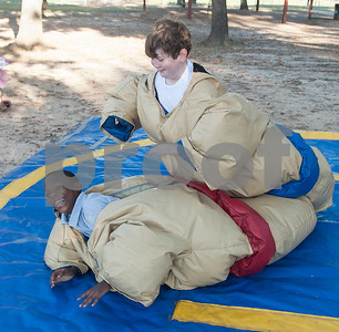 Keaton Davis, 10, and Jaylon Smith, 11, sumo wrestle during the Fit City Day in the Park event at Fun Forest Park in Tyler Saturday Oct. 29, 2016. Fit City Coalition sponsored fitness activities such as yoga and zumba classes, health screenings, a plank contest and health related vendors at the annual event.  (Sarah A. Miller/Tyler Morning Telegraph)
