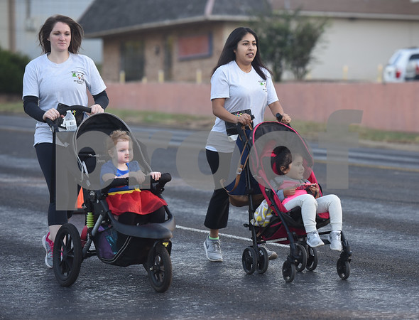 Erica Stegall and Carmen Garcia push their daughters in strollers in the Run for Your Life 5k sponsored by the Smith County Medical Society Foundation during the Fit City Day in the Park event at Fun Forest Park in Tyler Saturday Oct. 29, 2016. Fit City Coalition sponsored fitness activities such as yoga and zumba classes, health screenings, a plank contest and health related vendors at the annual event.  (Sarah A. Miller/Tyler Morning Telegraph)