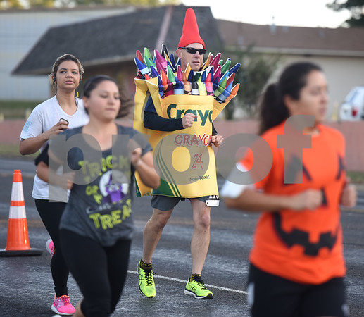 Derek Mitchell runs in a Crayola costume in the Run for Your Life 5k sponsored by the Smith County Medical Society Foundation during the Fit City Day in the Park event at Fun Forest Park in Tyler Saturday Oct. 29, 2016. Fit City Coalition sponsored fitness activities such as yoga and zumba classes, health screenings, a plank contest and health related vendors at the annual event.  (Sarah A. Miller/Tyler Morning Telegraph)