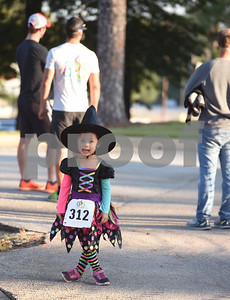 Julia Mitchell, 4, of Tyler, wears a witch costume at the Run for Your Life 5k sponsored by the Smith County Medical Society Foundation during the Fit City Day in the Park event at Fun Forest Park in Tyler Saturday Oct. 29, 2016. Fit City Coalition sponsored fitness activities such as yoga and zumba classes, health screenings, a plank contest and health related vendors at the annual event.  (Sarah A. Miller/Tyler Morning Telegraph)