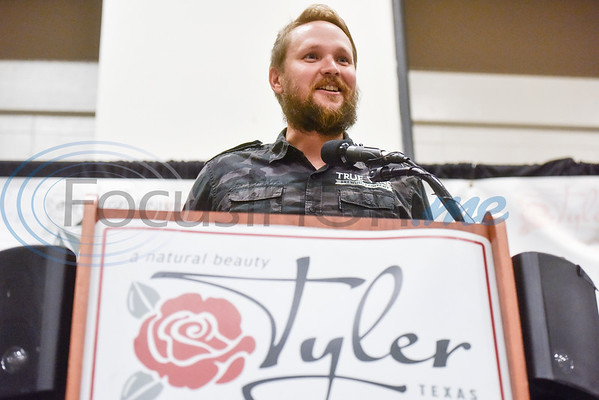 Ryan Dixon of True Vine Brewing Co. accepts the Small Business of the Year Award during the Chamber of Commerce's annual meeting at Harvey Convention Center in Tyler, Texas, on Tuesday, Oct. 2, 2018. (Chelsea Purgahn/Tyler Morning Telegraph)