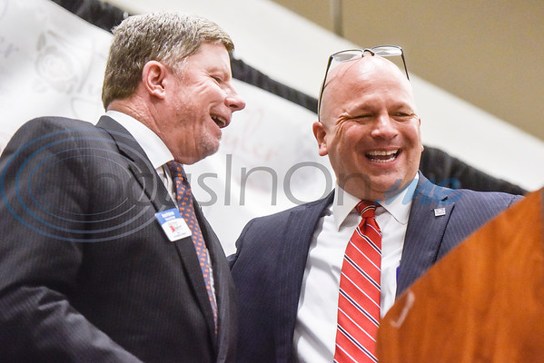Chamber of Commerce Chairman Howard Patterson and Chairman-Elect Skip Ogle laugh as Ogle steps to the podium to give remarks during the Chamber of Commerce's annual meeting at Harvey Convention Center in Tyler, Texas, on Tuesday, Oct. 2, 2018. (Chelsea Purgahn/Tyler Morning Telegraph)