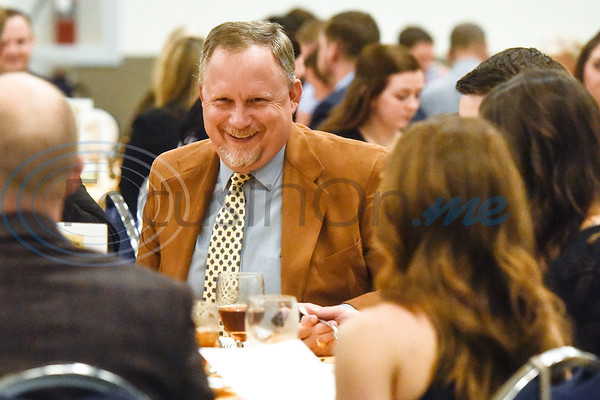 Duane Morrow laughs as he chats with others during the Chamber of Commerce's annual meeting at Harvey Convention Center in Tyler, Texas, on Tuesday, Oct. 2, 2018. (Chelsea Purgahn/Tyler Morning Telegraph)
