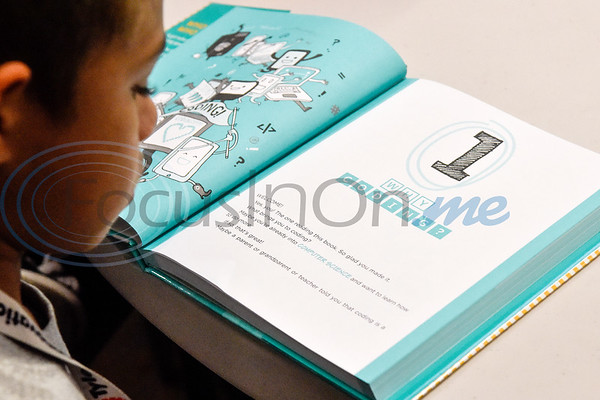 Isaac O'Neal, 9, reads from the Girls Who Code book during the first Girls Who Code meeting at the Innovation Pipeline in Tyler, Texas, on Wednesday, Oct. 3, 2018. Girls Who Code is a nonprofit organization which aims to support and increase the number of women in computer science. (Chelsea Purgahn/Tyler Morning Telegraph)