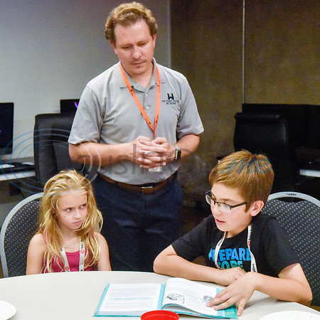 Devyn Smith, 8, and Cody Grace listen as Noah Gentry, 11, reads from the Girls Who Code book during the first Girls Who Code meeting at the Innovation Pipeline in Tyler, Texas, on Wednesday, Oct. 3, 2018. Girls Who Code is a nonprofit organization which aims to support and increase the number of women in computer science. (Chelsea Purgahn/Tyler Morning Telegraph)