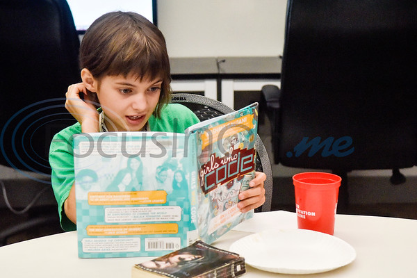 Bridget Neal, 10, reads from the Girls Who Code book during the first Girls Who Code meeting at the Innovation Pipeline in Tyler, Texas, on Wednesday, Oct. 3, 2018. Girls Who Code is a nonprofit organization which aims to support and increase the number of women in computer science. (Chelsea Purgahn/Tyler Morning Telegraph)