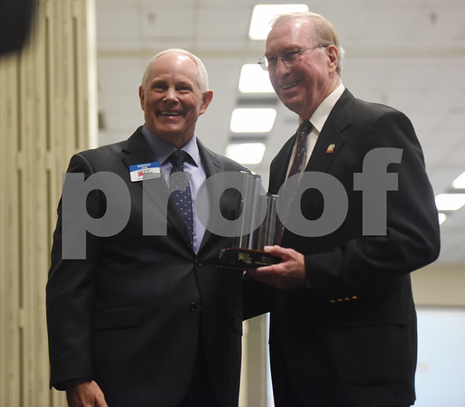 Bob Westbrook, left, gives Jim Snow the volunteer of the year award at the Tyler Area Chamber of Commerce annual meeting Tuesday night at Harvey Convention Center.   (Sarah A. Miller/Tyler Morning Telegraph)