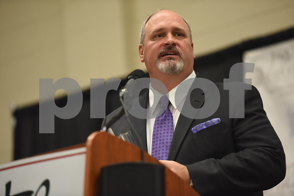 Mike Thomas of VME Fabricators accepts the Large Business of the Year Award at the Tyler Area Chamber of Commerce annual meeting Tuesday night at Harvey Convention Center.   (Sarah A. Miller/Tyler Morning Telegraph)