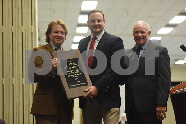 Garnett Brookshire, center, is presented the W.C. Windsor Award at the Tyler Area Chamber of Commerce annual meeting Tuesday night at Harvey Convention Center.   (Sarah A. Miller/Tyler Morning Telegraph)