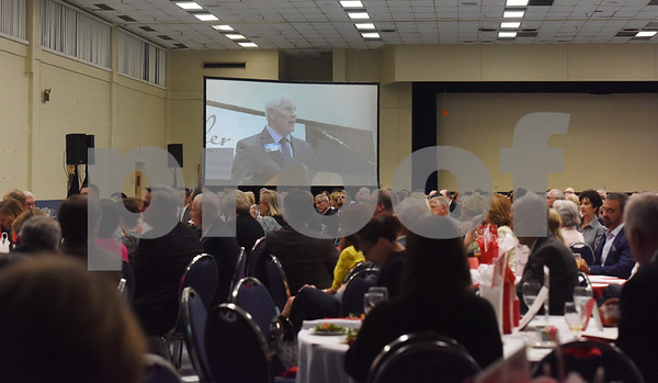 Outgoing Tyler Area Chamber of Commerce Bob Westbrook is projected onto a large screen as he speaks from the podium Tuesday evening at the organization's annual meeting at Harvey Convention Center.  (Sarah A. Miller/Tyler Morning Telegraph)