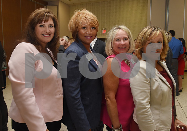 Sueanne Holland, Karla Hollins, Sue Walker and Kristy Johnson attend the Tyler Area Chamber of Commerce annual meeting at Harvey Convention Center Tuesday night Oct. 4, 2016.  (Sarah A. Miller/Tyler Morning Telegraph)
