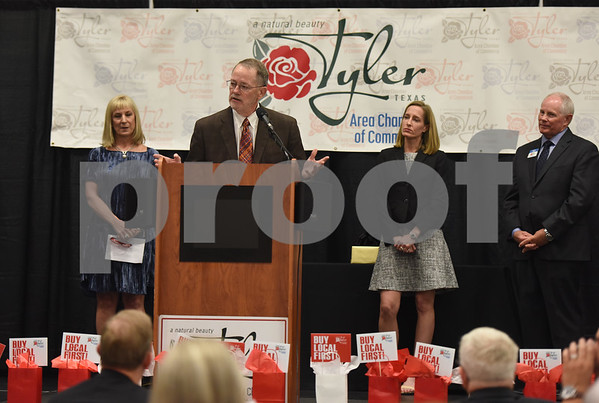 Doug McSwane speaks after receiving the T.B. Butler Award at the Tyler Area Chamber of Commerce annual meeting Tuesday night at Harvey Convention Center. Doug and Mary Mozelle McSwane are the organizers of a mental health conference called Peace of Mind.  (Sarah A. Miller/Tyler Morning Telegraph)