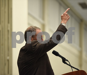 Doug McSwane points to God as he receives the T.B. Butler Award at the Tyler Area Chamber of Commerce annual meeting Tuesday night at Harvey Convention Center. Doug and Mary Mozelle McSwane are the organizers of a mental health conference called Peace of Mind.  (Sarah A. Miller/Tyler Morning Telegraph)