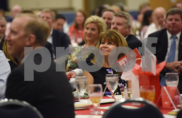 Sharon Mullins, center, attends the Tyler Area Chamber of Commerce annual meeting Tuesday night at Harvey Convention Center.   (Sarah A. Miller/Tyler Morning Telegraph)