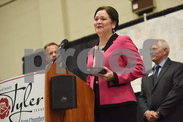 Rosemary Jones of Ramey & Flock PC accepts the Small Business of the Year Award at the Tyler Area Chamber of Commerce annual meeting Tuesday night at Harvey Convention Center.   (Sarah A. Miller/Tyler Morning Telegraph)