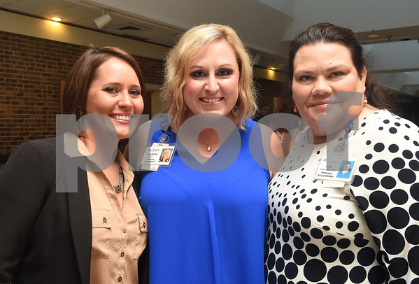 Ryan Tew, Courtney Klepfer and July Johnson-Minnick attend the Tyler Area Chamber of Commerce annual meeting at Harvey Convention Center Tuesday night Oct. 4, 2016.  (Sarah A. Miller/Tyler Morning Telegraph)