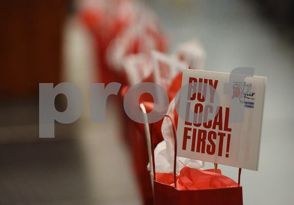 Table centerpieces advertise the Buy Local First campaign at the Tyler Area Chamber of Commerce annual meeting Tuesday night at Harvey Convention Center.   (Sarah A. Miller/Tyler Morning Telegraph)