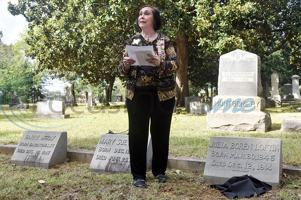 Johnnie McWilliams reads the biography of Julia Graham Boren Loftin during a memorial event hosted by the Charles G. Davenport chapter of the Daughters of the Republic of Texas at Oakwood Cemetery in Tyler, Texas, on Thursday, Oct. 4, 2018.The event honored real daughters, daughters of Texas pioneer families living in Texas during the Republic of Texas era, and members unveiled plaques at the real daughters' grave sites. (Chelsea Purgahn/Tyler Morning Telegraph)