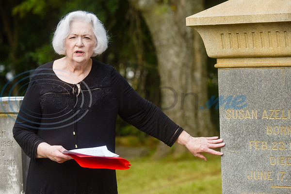 Mary June Goodson reads the biography of Susan Azelie Davenport Durst during a memorial event hosted by the Charles G. Davenport chapter of the Daughters of the Republic of Texas at Oakwood Cemetery in Tyler, Texas, on Thursday, Oct. 4, 2018.The event honored real daughters, daughters of Texas pioneer families living in Texas during the Republic of Texas era, and members unveiled plaques at the real daughters' grave sites. (Chelsea Purgahn/Tyler Morning Telegraph)