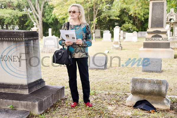 Sarah Beene reads the biography of Mary Jane Boren Pegues during a memorial event hosted by the Charles G. Davenport chapter of the Daughters of the Republic of Texas at Oakwood Cemetery in Tyler, Texas, on Thursday, Oct. 4, 2018.The event honored real daughters, daughters of Texas pioneer families living in Texas during the Republic of Texas era, and members unveiled plaques at the real daughters' grave sites. (Chelsea Purgahn/Tyler Morning Telegraph)