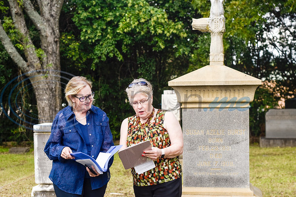 Laura Giles and president Kathi Snow go over the program during a memorial event hosted by the Charles G. Davenport chapter of the Daughters of the Republic of Texas at Oakwood Cemetery in Tyler, Texas, on Thursday, Oct. 4, 2018.The event honored real daughters, daughters of Texas pioneer families living in Texas during the Republic of Texas era, and members unveiled plaques at the real daughters' grave sites. (Chelsea Purgahn/Tyler Morning Telegraph)