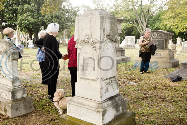 """President Kathi Snow, right, reads the biography of Lenora """"Nonie"""" Alabama Boren Mahoney during a memorial event hosted by the Charles G. Davenport chapter of the Daughters of the Republic of Texas at Oakwood Cemetery in Tyler, Texas, on Thursday, Oct. 4, 2018.The event honored real daughters, daughters of Texas pioneer families living in Texas during the Republic of Texas era, and members unveiled plaques at the real daughters' grave sites. (Chelsea Purgahn/Tyler Morning Telegraph)"""