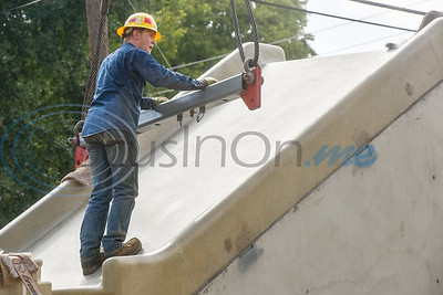 Jonah Copeland moves a piece attached to a crane to latch onto a 27,000 pound concrete slide being installed at Hillside Park in Tyler, Texas, on Thursday, Oct. 4, 2018. (Chelsea Purgahn/Tyler Morning Telegraph)
