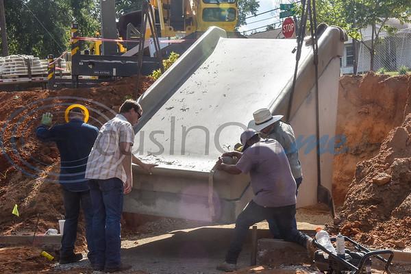 People install a 27,000 pound concrete slide at Hillside Park in Tyler, Texas, on Thursday, Oct. 4, 2018. (Chelsea Purgahn/Tyler Morning Telegraph)