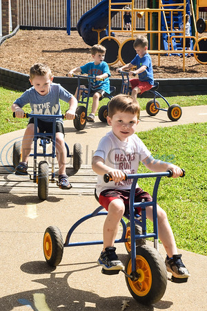 Children ride tricycles during the Kids Kaleidoscope Preschool Toddler Fair at Pollard United Methodist Church in Tyler, Texas, on Thursday, Oct. 4, 2018. (Chelsea Purgahn/Tyler Morning Telegraph)