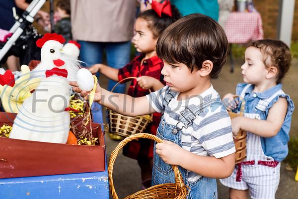 John Liam Scroggins, 2, picks up an egg during the Kids Kaleidoscope Preschool Toddler Fair at Pollard United Methodist Church in Tyler, Texas, on Thursday, Oct. 4, 2018. (Chelsea Purgahn/Tyler Morning Telegraph)