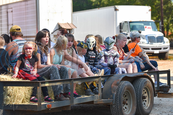 Children dressed in costumes enjoy a hayride at the 11th Annual Family Fun Day hosted by Joe Smith Plant Farms. The free event took place on Saturday, October 5 and included face painting, petting zoo, food, games and train rides. (Jessica T. Payne/Tyler Morning Telegraph)