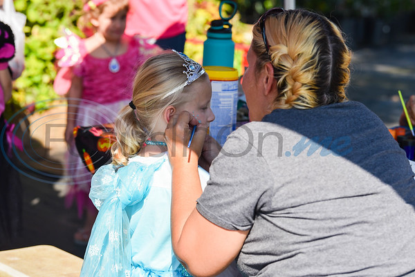 Dressed as a princess, Summer Todd (6), gets her face painted while attending the 11th Annual Family Fun Day hosted by Joe Smith Plant Farms in Jacksonville. The free event took place on Saturday, October 5 and also included a petting zoo, food, games and train rides. (Jessica T. Payne/Tyler Morning Telegraph)