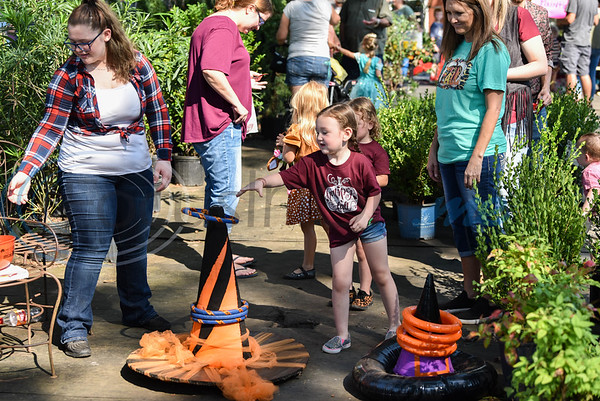 Peaton Roach, 4, throws a ring around a witch hat while attending the 11th Annual Family Fun Day hosted by Joe Smith Plant Farms in Jacksonville. The free event took place on Saturday, October 5 and  included a petting zoo, food, games and train rides. (Jessica T. Payne/Tyler Morning Telegraph)