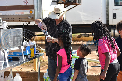 A volunteer from Sale Barn Sunday Cowboy Church makes children snow cones at the 11th Annual Family Fun Day. The church donated the food for the event which took place at Joe Smith Plant Farms on Saturday, October 5. (Jessica T. Payne/Tyler Morning Telegraph)