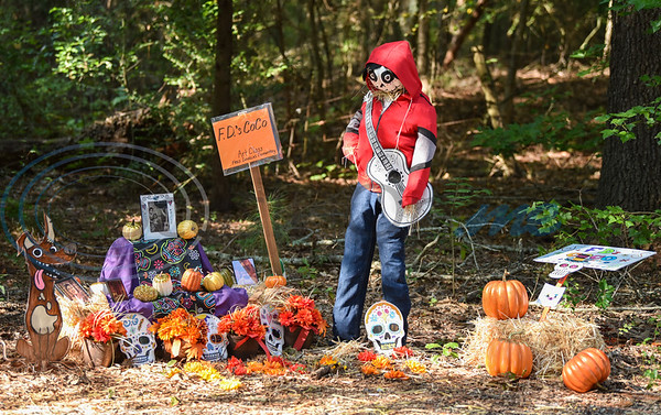 A scarecrow, decorated by a Fred Douglass art class, stands on display at the annual Scarecrow Trail at Ruth Bowling Nichols Arboretum. The event entry fee is $1 or a canned good which goes to help the H.O.P.E. Center in Jacksonville. (Jessica T. Payne/Tyler Morning Telegraph)