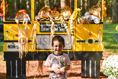 Bentlee Rios, 3, smiles for a photo while standing in front of a JISD scarecrow display at the annual Scarecrow Trail in Jacksonville. The two-week event kicked off on Saturday, October 5 at Ruth Bowling Nichols Arboretum and will run until Thursday, October 17. (Jessica T. Payne/Tyler Morning Telegraph)