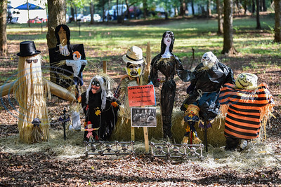 A scarecrow scene from The Adam's Family stands on display at the annual Scarecrow Trail in Jacksonville. The two-week event kicked off on Saturday, October 5 at Ruth Bowling Nichols Arboretum and will run until Thursday, October 17. (Jessica T. Payne/Tyler Morning Telegraph)