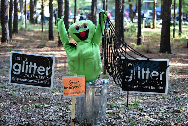 A scarecrow, decorated as Oscar the Grouch by the Keep Jacksonville Beautiful group, stands on display at the annual Scarecrow Trail at Ruth Bowling Nichols Arboretum. The event entry fee is $1 or a canned good which goes to help the H.O.P.E. Center in Jacksonville. (Jessica T. Payne/Tyler Morning Telegraph)