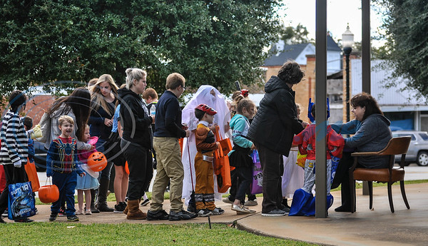 Rusk families line up outside of Citizens 1st Bank to collect candy for Halloween while attending Scare on the Square. The event took place in downtown Rusk and was hosted by Rusk Chamber of Commerce. (Jessica T. Payne/Tyler Morning Telegraph)